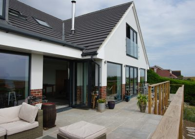 Large chalet bungalow reformed even larger with balance and panoramic view